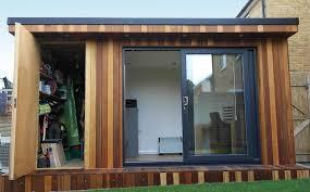 garden office with storage. Garden Office With Hidden Storage Shed Built By Fortress , Surrey:  Modern Study/ Garden Office