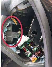 removing a w203 mirror and light switch console mercedes benz remove the screw holding the fuse box in place then slide the box down it should come loose