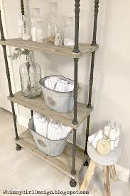 glass apothecary jars hold items we use daily but also double as accessories our towels are d in these galvanized buckets for easy access