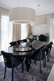 clily styled dining room given some oomph with the heavily patterned rug the konstancin house by nasciturus design