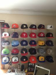 My hat collection is complete. One hat from each team and a sweet way to  display it. I think my dad and I should patten this design