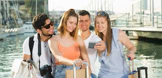 four happy travellers making selfie with mobile phone on vacations stock photo 100300614