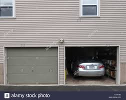 garage inside with car. Open Garage Door With Car Parked Inside, American Style Wooden House, USA. Inside