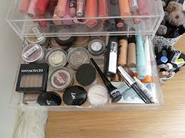the second drawer holds some eye s primers brow y most used single eyeshadows and bases
