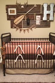 rustic crib furniture. orange diamond crib bedding in a rustic nursery furniture