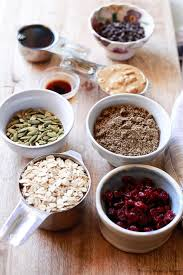 healthy ings like oats flax pepitas and cranberries ready to be made into