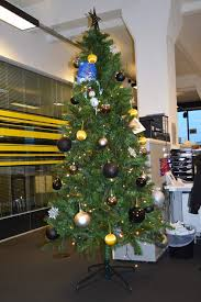 office christmas decoration. Black And Golden Balls Decorated Christmas Tree For Office Decoration