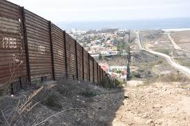 a portion of the fence along the u s border with mexico in southern california photo bbc world service