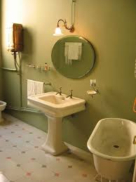 funky bathroom lights: bathroom small circle bathroom wall mirror combined with classical artistic bathroom wall lamp with yellow shade and bright white bathroom sink with two