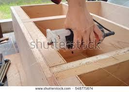 cutting edge furniture. Carpenter Are Using A Router Cutting Edge Smoothing. Carpenters Building Furniture. Furniture
