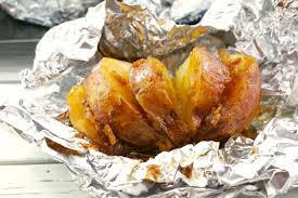baked potatoes in foil onion food