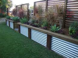 corrugated steel panels installed vertically as garden edging
