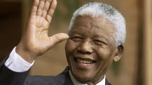 Former South African president Nelson Mandela waves to the crowd during a ceremony in Quebec, where he was presented with an honourary Canadian citizenship ... - nelson-mandela-20131205