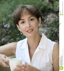 mature woman  Cheerful mature woman  Portrait of happy mature woman looking  at camera and    RF com
