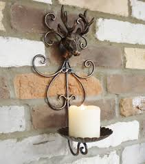 antique style metal stag head candle