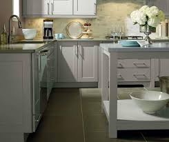 light grey kitchen cabinets by kemper cabinetry
