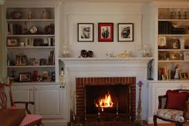 home design beautiful brick fireplace mantle exposed with nice artwork pictures and charming white wooden built in shelves with storage interior furnishing