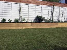 Painted Fences hardwood privacy screen travertine paving fencing painted planting 2400 by xevi.us