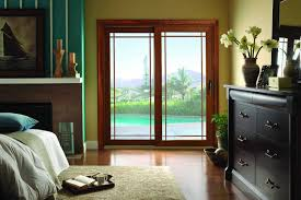 sliding glass patio doors from american thermal window are an easy way to seamlessly expand your living space onto your patio or backyard
