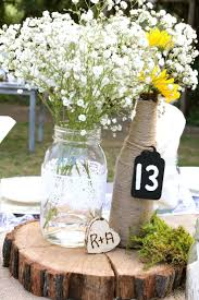 Mason Jar Table Decorations Wedding Wedding Idea Baby's breath in blue mason jars is a cute idea for 13