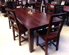 take a load of this solid wood dining room table and chairs it has rich