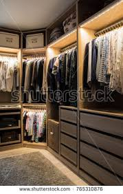 luxurious walk in closet. Luxurious Walk In Closet With Lighting And Jewelry Display.