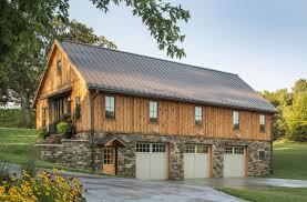 Barn Home with stone around the 3 car garage. Sand Creek Post & Beam Wood