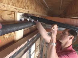 install garage door openerHow to Install a CarriageStyle Garage Door Opener