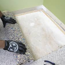 Rolling Old Carpet Pad Away From The Subfloor