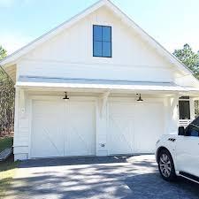 coastal garage doorsLove our barn lights from barnlightelectric custom carriage
