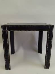 an elegant pair of french mid century modern style black leather studded side tables