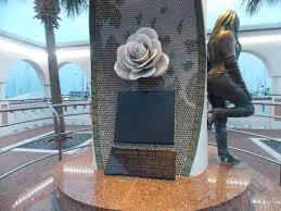 the memorial is decorated with mosaic tiles of white roses a favorite flower of the singer our day sunday ended with a concert given by the