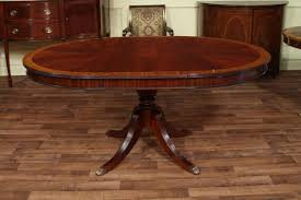 heirloom quality traditional mahogany dining table round to oval expands to 66