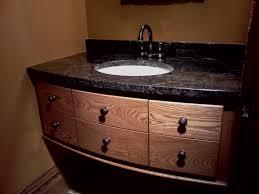 costco natural wood bathroom vanity with black granite top and white undermount sink plus bronze faucet design