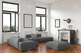 stylish living room comfortable. Stock Photo - Stylish Living Room Interior With Fireplace And Comfortable Grey Lounge Suite On A Hardwood Floor Below Two Windows View Of The Garden. P