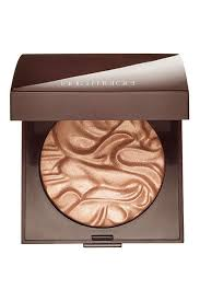 this gorgeous illuminating powder from laura mercier works well on fair to um skinned las who can pull off basically any highlight