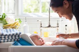 bathing baby in farmhouse sink image and toaster