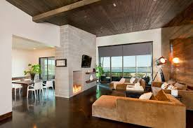 Example of a trendy concrete floor living room design in Austin with a  wall-mounted