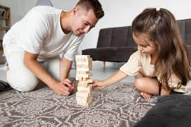 Free Photo | Father and daughter playing a game together