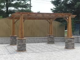 pergola 50p. wood pergola with stone pillars on a back patio 50p