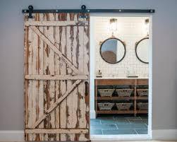 rustic barn door opens to master bathroom