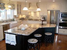 Example of a country kitchen design in Newark with glass-front cabinets and  granite countertops