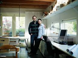 architect home office. Husband And Wife Architect Team In Home Office : Stock Photo
