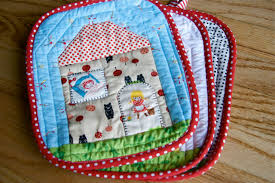 a quilt is nice: potholders & I have been making potholders lately! My first attempt at potholders, and  they are FUN! I used this tutorial, because they are just too cute. Adamdwight.com