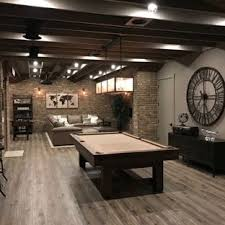 basement ideas. Urban Look-out Medium Tone Wood Floor And Brown Basement Photo In  Atlanta With Ideas