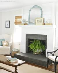 painted white brick fireplace11 Brick Fireplace Makeovers