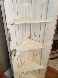 corner shelf from old door cut full size door in half or use small bi fold doors more