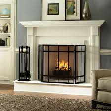interesting big home depot fireplace with black iron safe fireguard and cabinet wall also brown rug