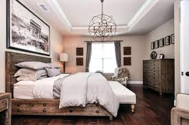 foucaults orb traditional master bedroom with chandelier hardwood floors high ceiling clear crystal