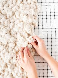 Amazing tutorial for how to make a large-scale rug from scratch. It's over